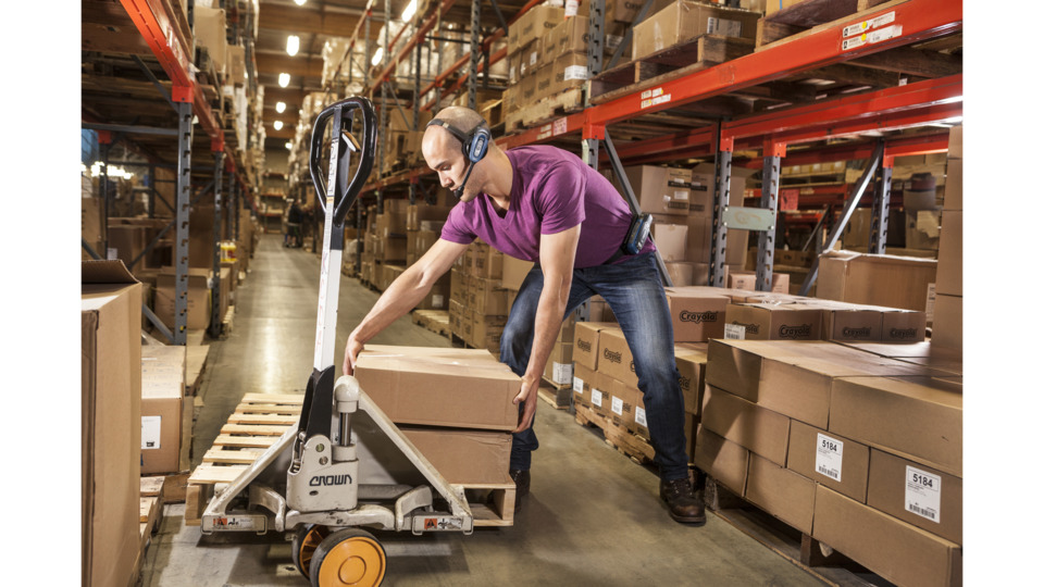Man lifting in warehouse